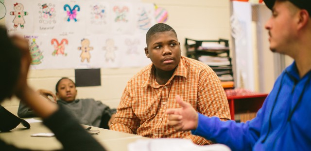 Jim Courtney-Clarks, 15, talks with Army veteran Alberto Bóleros during the Urban Warriors program in December. The Chicago program is designed to bring together veterans and youth who have been exposed to the city's violence.