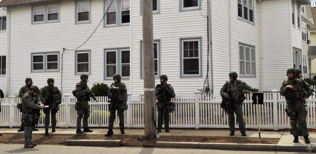 Law enforcement searches houses in Watertown days after the Boston Marathon bombing. Watertown resident Maria Van Ryn balked at the idea of Patriots Day re-creating the 2013 shootout in her neighborhood. Timothy A. Clary/AFP/Getty Images