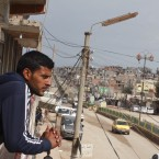 Manaf Ibrahim takes a break from making sandwiches in a small town close to an airstrip he believes the U.S. is using to supply its advisers on the ground in eastern Syria.