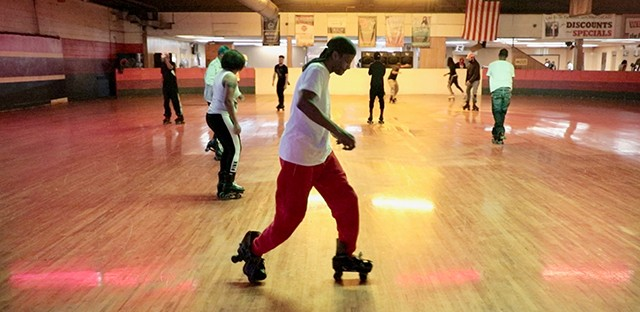 "Dozens of people roller skate in The Rink at 1122 E. 87th St.. For decades, the Chatham neighborhood venue has been a hub for ""JB"" skating, a style inspired by the smooth dance moves of singer James Brown."