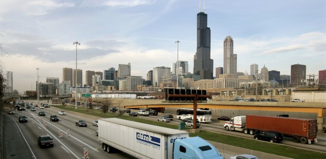 Chicago's Sears Tower dominates the skyline as cars and trucks pass barricades on the city's Dan Ryan Expressway Thursday, March 30, 2006