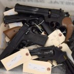 This June 2, 2018 photo provided by the Chicago Police Department shows weapons turned in by residents in a gun buy-back program co-sponsored with the New Life Covenant Church Southeast in the 6th Police District. More than 400 guns and rifles were handed over in exchange for $100 gift cards. (CPD via AP)