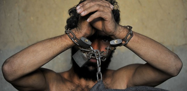 A mentally ill patient in Afghanistan at the Mia Ali Baba holy shrine in the village of Samar Khel. The mentally ill are thought to be possessed by demons so they're chained for 40 days.