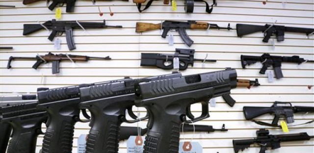 In this Jan. 16, 2013 file photo, assault weapons and handguns are seen for sale at Capitol City Arms Supply in Springfield, Ill. In a questionnaire for The Associated Press, the four GOP candidates for governor, state Sens. Bill Brady and Kirk Dillard, state Treasurer Dan Rutherford and businessman Bruce Rauner disagree on whether assault-style weapons should be banned. They also disagree on whether to support a measure creating minimum prison sentences for gun crimes.