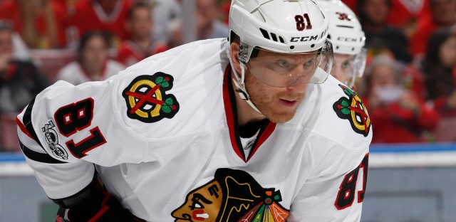 In this Saturday, March 25, 2017, file photo, Chicago Blackhawks right wing Marian Hossa (81) prepares for a face off against the Florida Panthers during the first period of an NHL hockey game, in Sunrise, Fla. Hossa will miss the entire 2017-18 NHL season because of a progressive skin disorder, the team announced the news early Wednesday, June 21, 2017.
