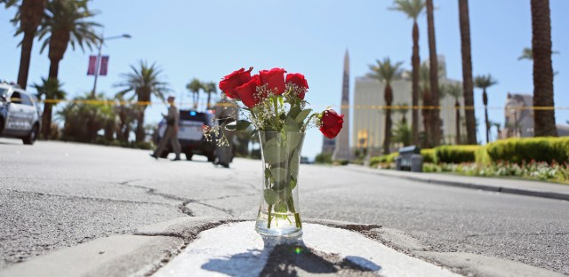 A vase of roses is shown at the edge of a police barricade on the Las Vegas Strip Monday, Oct. 2, 2017, in Las Vegas.