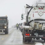 Crews clean up the diesel fuel spill after a pipeline broke in Worth County, Iowa on Wednesday.