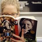 Linda Leseman reads Hillary Clinton's memoir, Living History, while riding the New York City subway Tuesday.