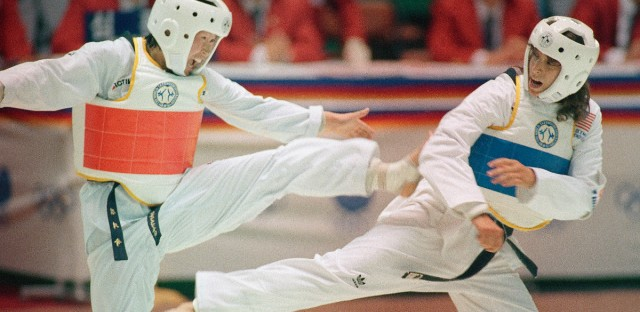 Arlene Limas of Chicago, right, is seen Sept. 17, 1988, during her gold medal winning taekwondo match against South Korea's Kim Ji Sook at the Summer Olympic Games in Seoul.