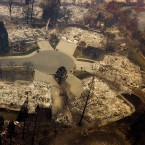 Residences leveled by the Camp Fire line a cul-de-sac in Paradise, Calif., earlier this month. A massive federal report says climate change is contributing to larger wildfires as well as other deadly extreme weather.