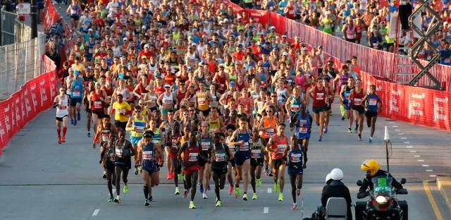 Runners start the Chicago Marathon, Sunday, Oct. 9, 2016.