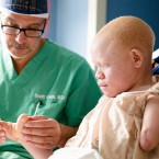 Dr. Scott H. Kozin examines 13-year-old Emmanuel Rutema, of Tanzania, who has the hereditary condition of albinism, before his surgery at the Shriners Hospital for Children in Philadelphia on Tuesday, June 30, 2015. People with the genetic condition, characterized by a lack of pigment, are often referred to in Tanzania as ghosts, or zero zero, which in Swahili signifies someone who is less than human. Witch doctors often lead brutal attacks to use albino body parts in potions they claim bring riches.