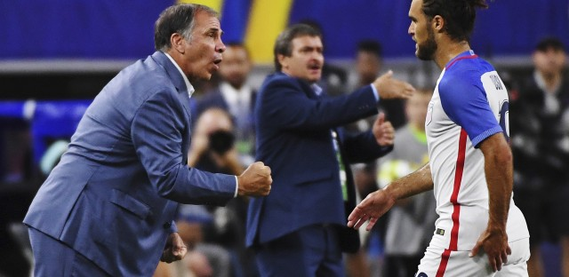 Coach Bruce Arena calls out to his team as U.S. player Graham Zusi steps off the field during a Gold Cup semifinal soccer match in Arlington, Texas earlier this month.