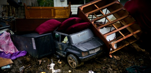 A toy car sits among items destroyed by flooding from Hurricane Maria, waiting to be picked up by the garbage service in the street in Toa Baja, Puerto Rico, Monday, Oct. 16, 2017.