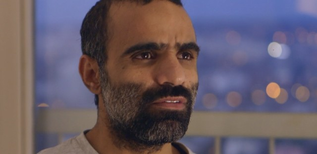 Mansoor al Dayfi sits in his apartment in Serbia. Al Dayfi was a detainee in Guantanamo Bay, Cuba and was resettled in Serbia.