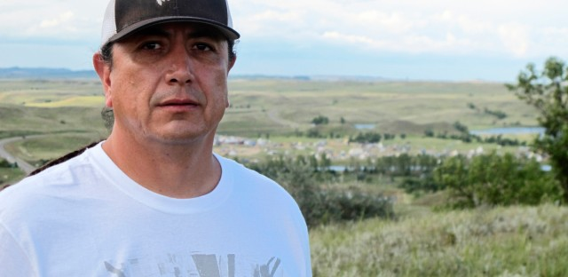 In this Aug. 26, 2016, photo, Standing Rock Sioux Chairman Dave Archambault II poses for a photo near Cannon Ball., N.D., on the Standing Rock Sioux Reservation overlooking an encampment where Native Americans from across North America have gathered to join his tribe's growing protest against a $3.8 billion four-state oil pipeline. About 30 people, including Archambault himself, have been arrested in recent weeks for interfering with construction of the Dakota Access pipeline.
