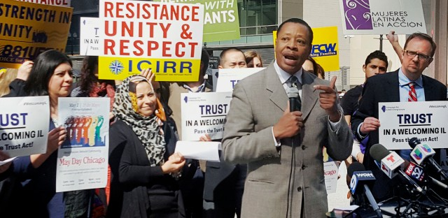 In this April 24, 2017 photo, Pastor Don Taylor, of a suburban Chicago organizing group, speaks to immigrant rights advocates in downtown Chicago. The advocates plan to march in a May 1 rally in Chicago.