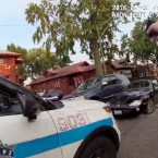 In this frame grab from a body cam provided by the Independent Police Review Authority, a Chicago police officer fires into a stolen car driven by Paul O'Neal on July 28, 2016, in Chicago. O'Neal's autopsy results showed he died of a gunshot wound to the back. The video released Friday, Aug. 5, 2016, was the city's first release of video of the fatal police shooting under a new Chicago policy that calls for such images to be made public within 60 days.