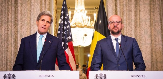 U.S. Secretary of State John Kerry stands alongside Belgian Prime Minister Charles Michel during a meeting in Brussels on Friday.