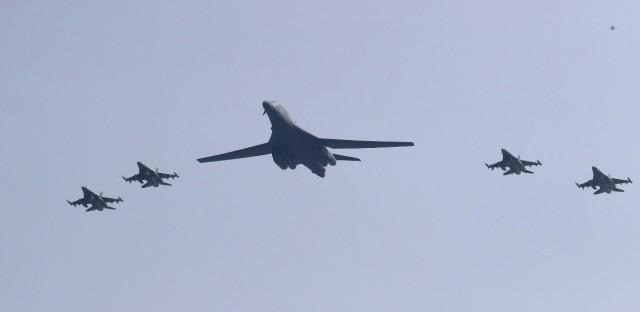 U.S. B-1 bomber, center, flies over Osan Air Base with U.S. jets in Pyeongtaek, South Korea, Tuesday, Sept. 13, 2016. Lee Jin-man