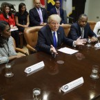 "President Trump, flanked by Omarosa Manigault and House and Urban Development Secretary-designate Ben Carson, holds an African-American History Month ""listening session"" on Wednesday."