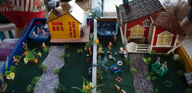 Which house does a better job keeping mosquitoes away? In this model set up by health workers to help prevent the spread of Zika, the one on the left appears to have less standing water, which is a magnet for mosquitoes.
