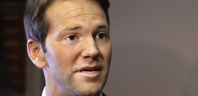 Former U.S. Rep. Aaron Schock speaks to members of the media in Peoria, Ill., in Feb. 2015.