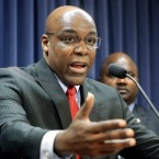 State Sen. Kwame Raoul, D-Chicago, speaks at a news conference at the Illinois State Capitol. Raoul, who is also the Democratic candidate for attorney general, is among lawmakers who say they'll push for stricter mandates around reviews of police shootings in Cook County suburbs.