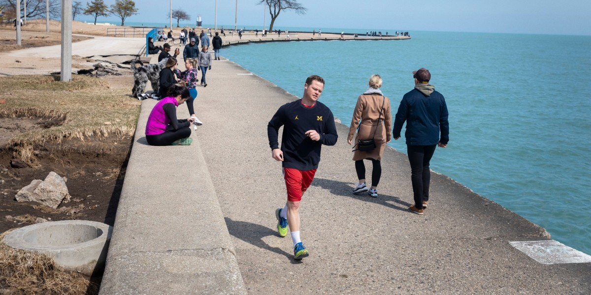 People exercise along the lakefront