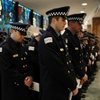 Police officers bow their heads during the funeral for Chicago Police Officer Conrad Gary, Friday, Dec. 21, 2018 at St. Rita of Cascia Shrine Chapel in Chicago. Gary was one of two Chicago officers who were struck and killed by a commuter train as they were investigating a report of gunfire in the area.