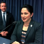 Illinois state Comptroller Susana Mendoza, accompanied by state Sen. Andy Manar, D-Bunker Hill, speaks to reporters at the state Capitol in Springfield, Ill. on Nov. 8, 2017.