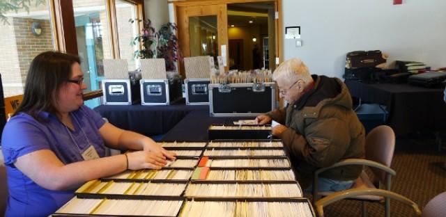 Megan Kellerman helps her father at stamp shows.