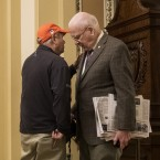 Sen. Lindsey Graham, R-S.C., and Sen. Patrick Leahy, D-Vt., talk to each other outside the Senate floor Sunday, as lawmakers worked toward a resolution to the government shutdown.