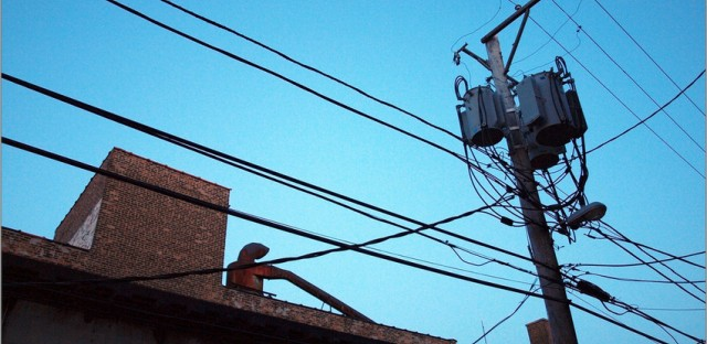 File: Power lines. The city of Chicago says residents have less than two weeks to opt out of a newly-instituted municipal electric aggregation program.