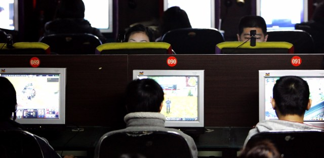 Chinese Internet surfers play online games on their computer stations at an Internet cafe in Beijing, China, Wednesday, Feb. 15, 2006.