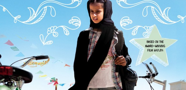 """<p>Wadjda looks at her desire, abicycle, on the book cover for Haifaa al-Mansour's the new young adult novel, """"The Green Bicycle.""""</p>"""