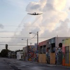 A plane sprays pesticide over the Wynwood neighborhood of Miami on August 6. That's just one way health officials are battling back Zika-carrying mosquitoes in the area.