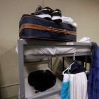 Beds are folded and clothes are stacked by residents at a Springfield homeless shelter in 2016. A new report from the anti-poverty organization Heartland Alliance shows wide gaps in poverty by gender and race in Illinois.