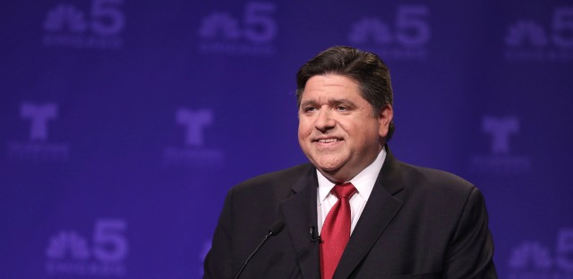 Democratic candidate for Illinois governor J.B. Pritzker takes his podium position before a televised forum Tuesday, Jan. 23, 2018, in Chicago.