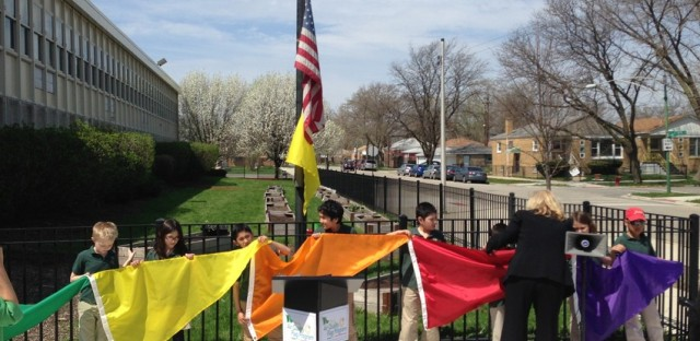 Kids from the Chicago Academy for Global Citizenship hold the color-coded flags to indicate air quality .