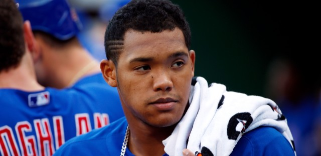 "Chicago Cubs' Addison Russell stands in the dugout during a baseball game against the Pittsburgh Pirates in Pittsburgh. Major League Baseball is looking into a domestic violence accusation against Russell. His wife, Melissa, posted a photo Wednesday on Instagram with a caption suggesting he was unfaithful to her. In another post, a user named carlierreed and described by Melissa as a close friend accused Russell of ""mentally and physically abusing her."" The posts have been deleted. Russell issued a statement Thursday, June 8,2 017, that said: ""Any allegation I have abused my wife is false and hurtful. For the well-being of my family, I'll have no further comment."" (AP Photo/Gene J. Puskar, File)"
