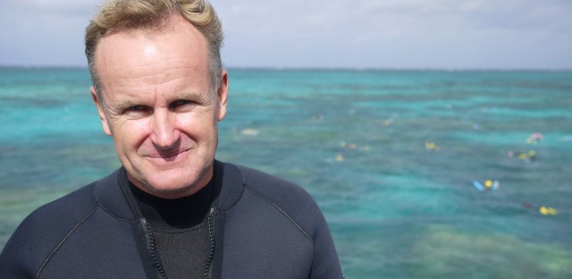 John Edmondson runs Wavelength Reef Cruises in Port Douglas, Australia. Trained as a marine biologist, Edmondson makes a point of explaining the science behind climate change and coral bleaching to his customers.