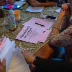 """In this Wednesday, June 19, 2019 photo, a flyer that reads """"Human Rights Watch Home, ICE Free Zone """" rests on a table during an emergency meeting plan of action on how to defend and protect undocumented communities of deportation at Lincoln Methodist Church in Chicago's Pilsen neighborhood. With renewed pledges on mass deportations, immigrant rights activists have fine-tuned and ramped up one of their most basic organizing tools: The know-your-rights training."""