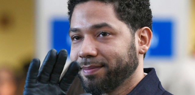 Actor Jussie Smollett waves to supporters before leaving Cook County Court on March 26, 2019 after charges against him were dropped in Chicago. On Friday, a judge named a special prosecutor to investigate how the case was handled.
