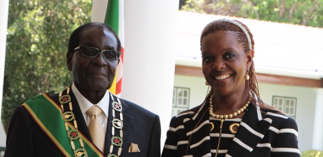 Zimbabwe President Robert Mugabe stands with his wife Grace, as they pose for a photo at State House in Harare, Tuesday, Oct, 28, 2014.