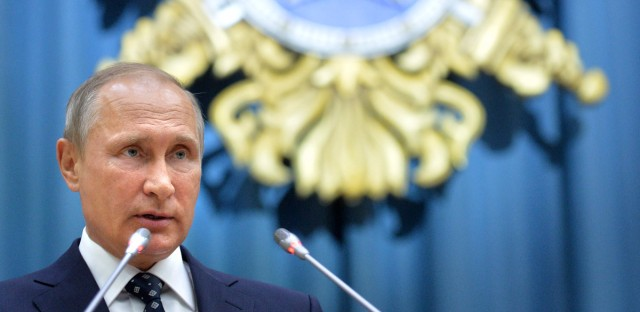Russian President Vladimir Putin speaks during a visit to Russian Foreign Intelligence Service ( SVR) in Moscow, Russia, Wednesday, Oct. 5, 2016. Putin presented Sergei Naryshkin, who previously served as the speaker of the lower house of parliament, as the new chief of the SVR.