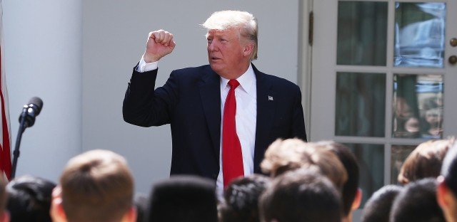 President Trump pumps a fist during a speech in the Rose Garden of the White House last month. On Wednesday, he unveiled legislation that would curtail legal immigration.