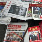 "A front page of a Chinese newspaper with a photo of U.S. President-elect Donald Trump and the headline ""Outsider counter attack"" is displayed at a newsstand in Beijing, China, Thursday, Nov. 10, 2016. Trump is a mixed blessing for Chinese leaders. His threats to tear up trade deals and hike tariffs on Chinese goods could chill thriving commercial ties when Beijing is struggling to shore up economic growth. At the same time, Trump's suggestion he might reduce Washington's global strategic presence to focus on domestic issues would be a gift to Chinese leaders. They could expand their political and military profile in East Asia with less risk of conflict."