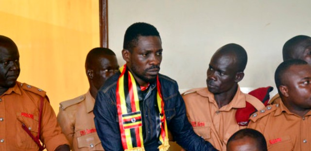 Ugandan pop star-turned-lawmaker Kyagulanyi Ssentamu, also known as Bobi Wine, center, arrives at a magistrate's court in Gulu, northern Uganda Thursday, Aug. 23, 2018. Bobi Wine, who opposes the longtime president Yoweri Museveni, was charged with treason in the civilian court in Gulu on Thursday, minutes after a military court dropped weapons charges.