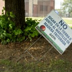 A Spanish-language EPA sign inside West Calumet Housing Complex warns residents against touching contaminated soil.